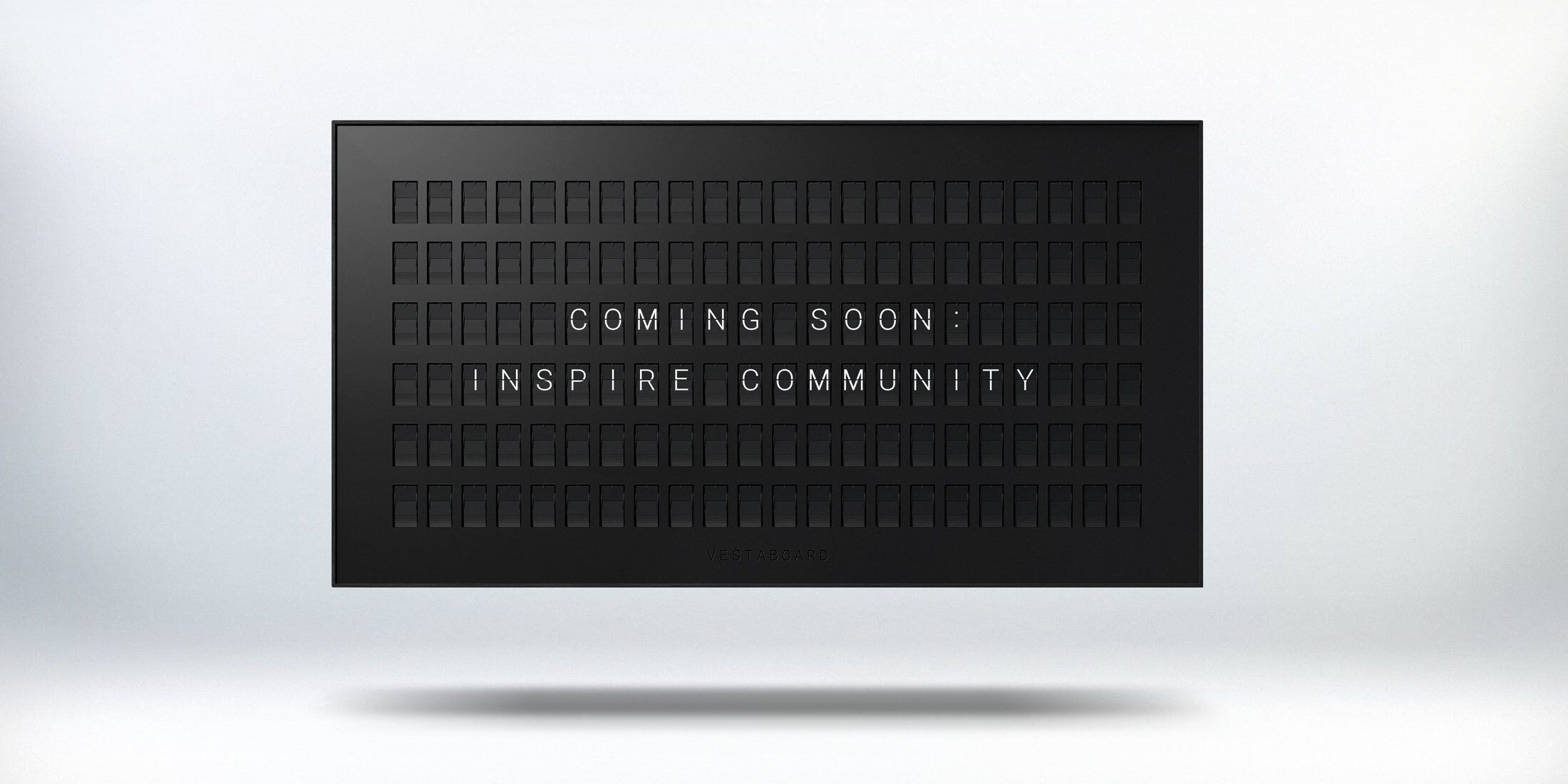 Vestaboard shows Coming Soon: Inspire Community