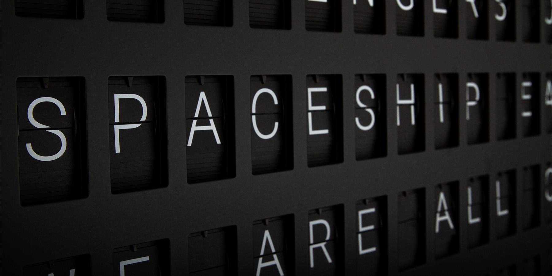 Vestaboard close up showing letters