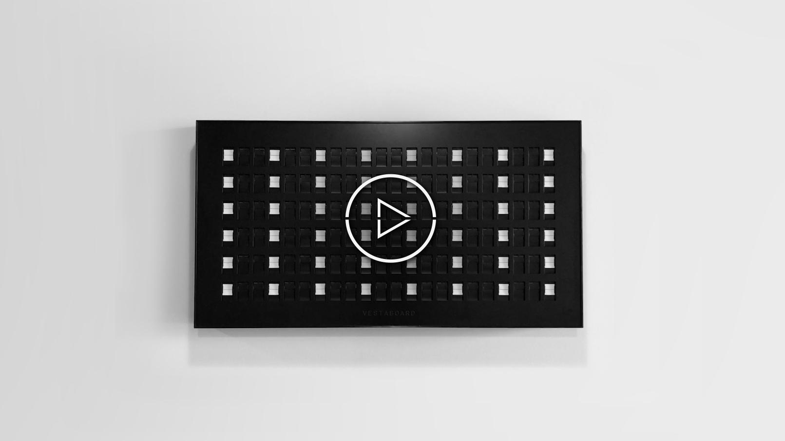 Vestaboard displays artistic white stripe bars on black background